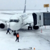 VIDEO: WestJet 737 at Halifax Airport Drifting Away From The Gate on Icy Apron Due To High Winds Hitting The Vertical Stabilizer