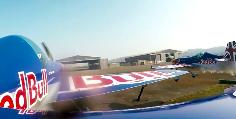 red-bull-barnstorming-side-by-side-fly-through-hangar-no